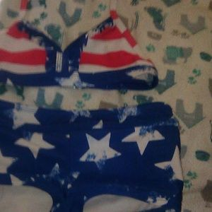 A children size 6x tie up fourth of July swimsuit